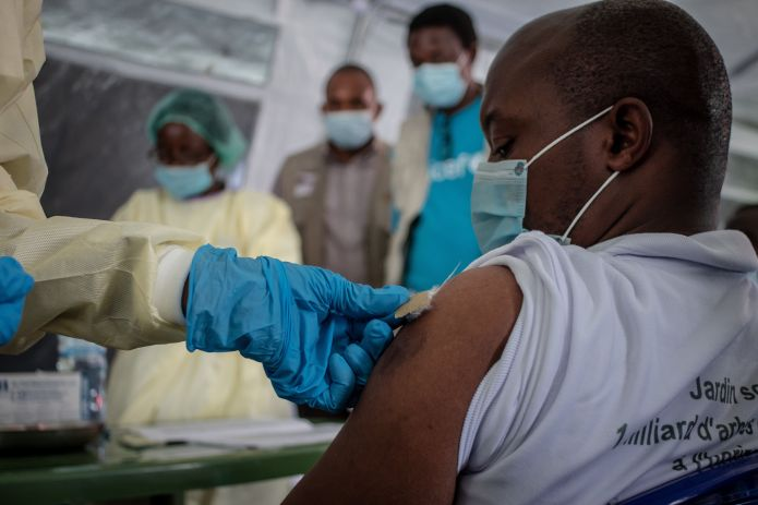 GOMA, DEMOCRATIC REPUBLIC OF CONGO - MAY 05: A health worker vaccinates a citizen with AstraZeneca during the vaccination cam