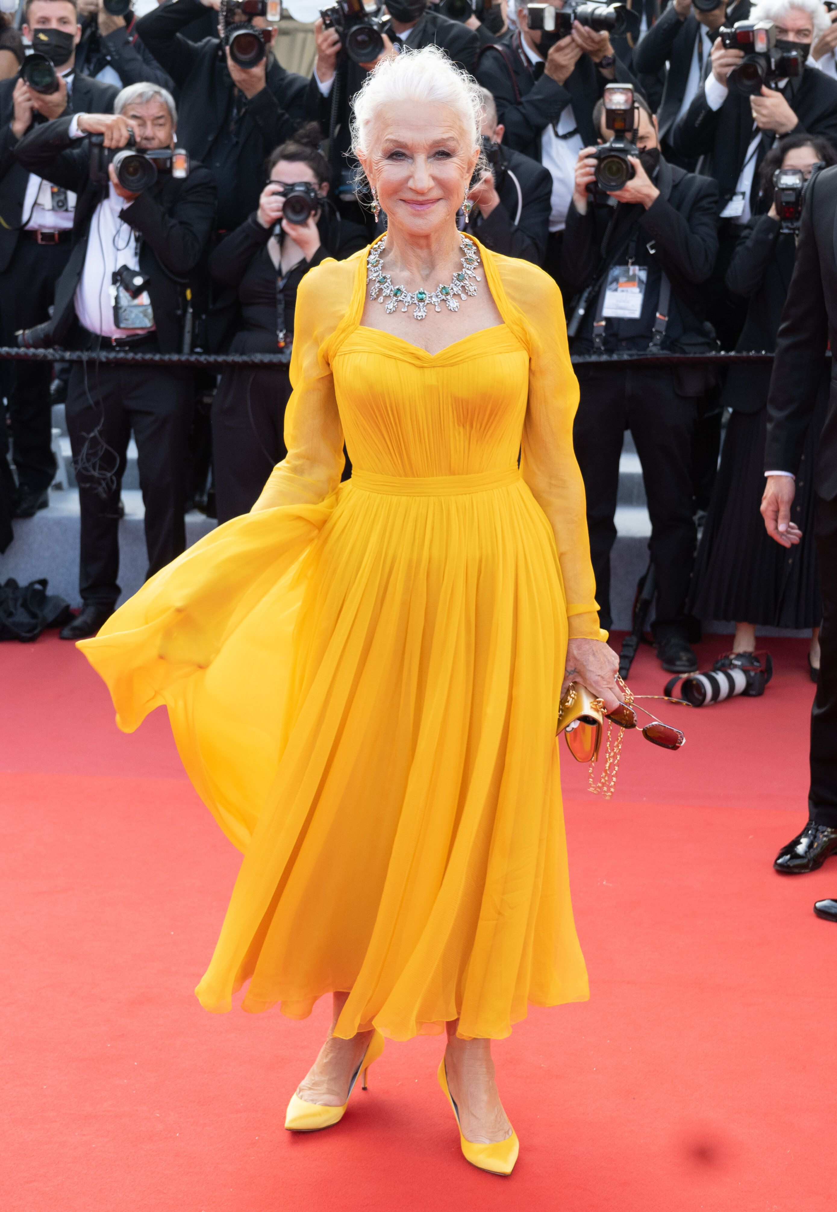 Helen Mirren attends the opening of the74th Annual Cannes Film Festival in Dolce & Gabbana gown.