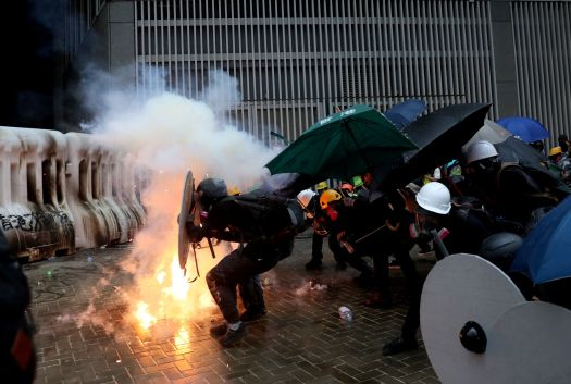 A photo taken by Danish Siddiqui shows demonstrators take cover during a protest in Hong Kong, China August 31, 2019. REUTERS