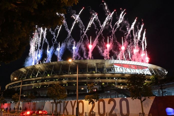 Fireworks light up the sky above the Olympic Stadium during the opening ceremony for the Tokyo 2020 Paralympic Games.