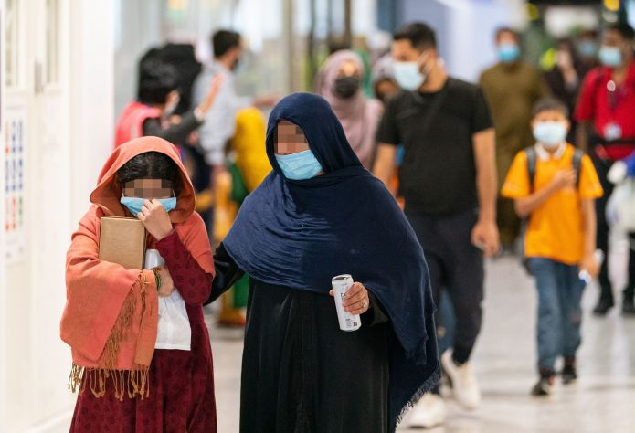 Refugees from Afghanistan arrive on a evacuation flight at Heathrow