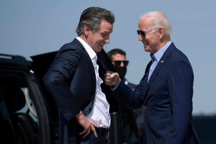 California Gov. Gavin Newsom (D) greets President Joe Biden on Monday. As part of an effort to drive up Democratic turnout, B