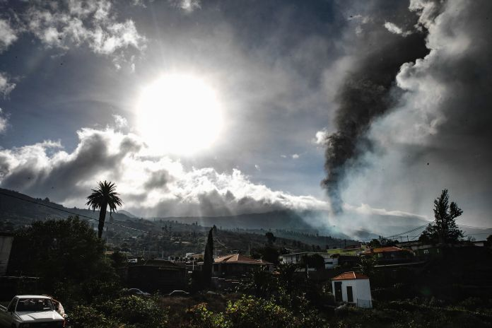 Smoke billows from a volcano near Los Llanos de Ariadne on the island of La Palma in the Canaries, Spain, on Sept. 21, 2021.&