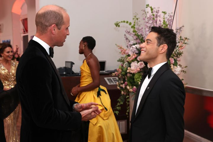 """Prince William meets some of the cast, including Rami Malek, at the """"No Time to Die"""" world premiere at Royal Albert Hall on Sept. 28 in London."""