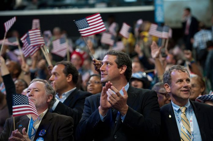 Ryan, second from right, stands next to Sen. Sherrod Brown (D-Ohio), right, at the 2012 Democratic National Convention. Brown is more progressive, but they both emphasize labor.