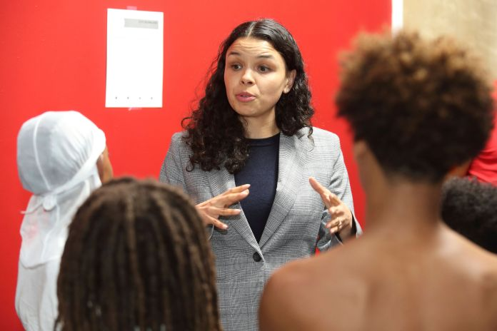 Morgan Harper speaks to anti-violence activists in March 2020. She is running against Ryan from the left in the Senate Democratic primary.