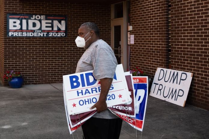 Tony Hickson holds signs in support of Joe Biden in Youngstown, Ohio, on September 22, 2020. The state has grown more elusive for Democrats in recent years.