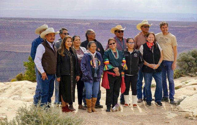 Board members, staff and supporters of the Indigenous-led group Utah Diné Bikéyah celebrate President Joe Biden's decision to restore the boundaries of Bears Ears National Monument at an overlook on Cedar Mesa in San Juan County on Oct. 8, 2021, in Utah.