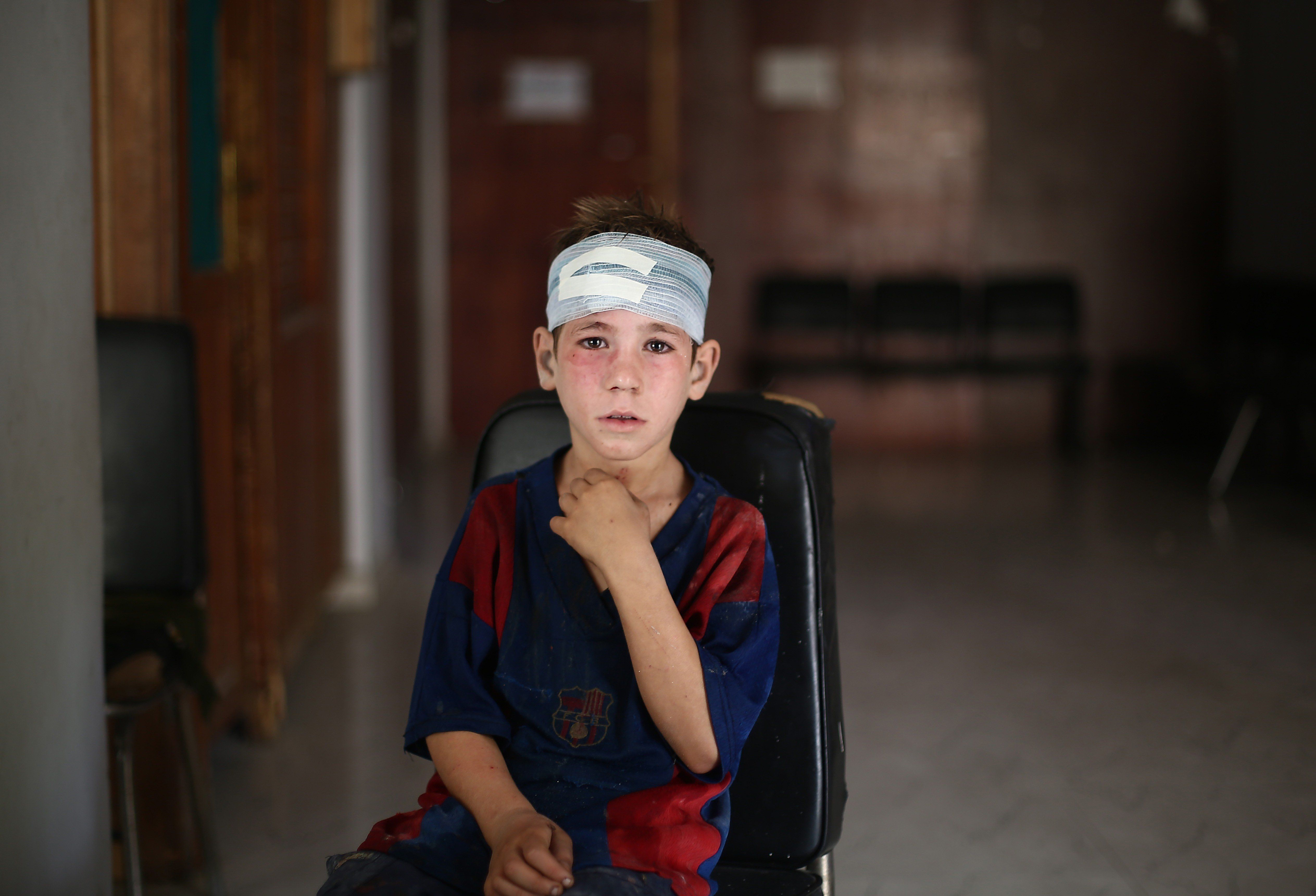 "<span class='image-component__caption' itemprop=""caption"">A child receives medical treatment after Syrian regime forces staged an airstrike in Damascus on Sept. 11, 2015.</span>"