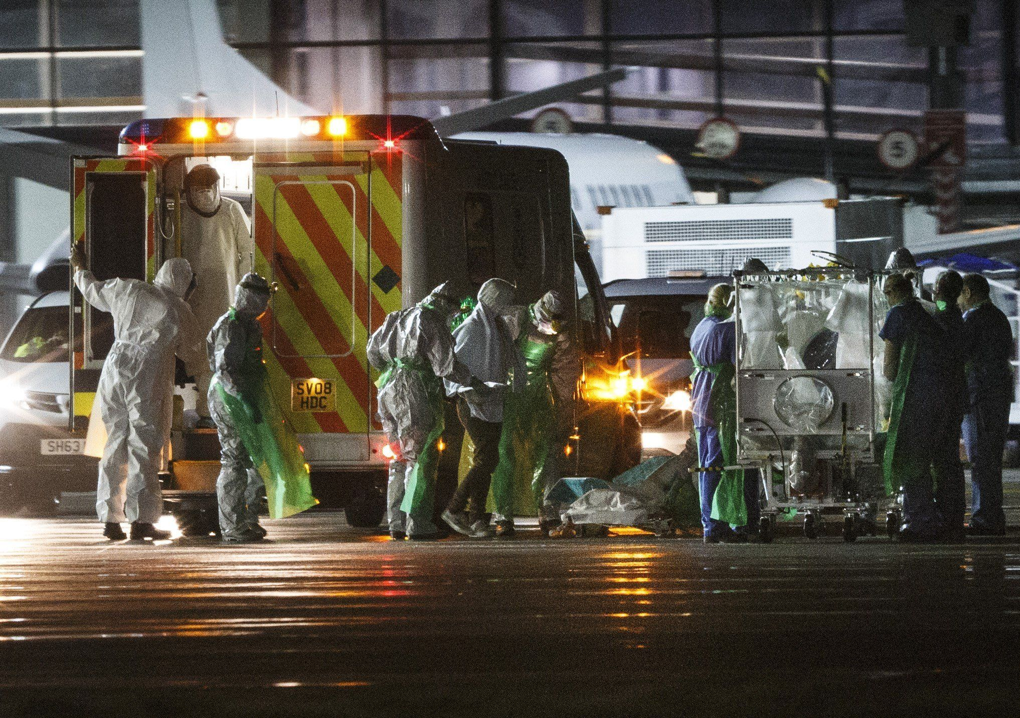 """<span class='image-component__caption' itemprop=""""caption"""">(FILES) A file photo taken on December 30, 2014, shows Scottish healthcare worker Pauline Cafferkey (C), who was diagnosed with Ebola after returning to Scotland from Sierra Leone, as she is escorted by medical personnel from an ambulance to a quarantine tent trolley (R), before being wheeled into a Hercules Transport plane at Glasgow International Airport, bound for The Royal Free hospital in London. British nurse Pauline Cafferkey who was successfully treated in January 2015 after contracting Ebola in Sierra Leone is now 'critically ill' due to a resurgence of the virus, the hospital treating her said on October 14, 2015. 'We are sad to announce that Pauline Cafferkey's condition has deteriorated and she is now critically ill. Pauline is being treated for Ebola in the high-level isolation unit at the Royal Free Hospital,' it said in a statement. AFP PHOTO / STR (Photo credit should read -/AFP/Getty Images)</span>"""
