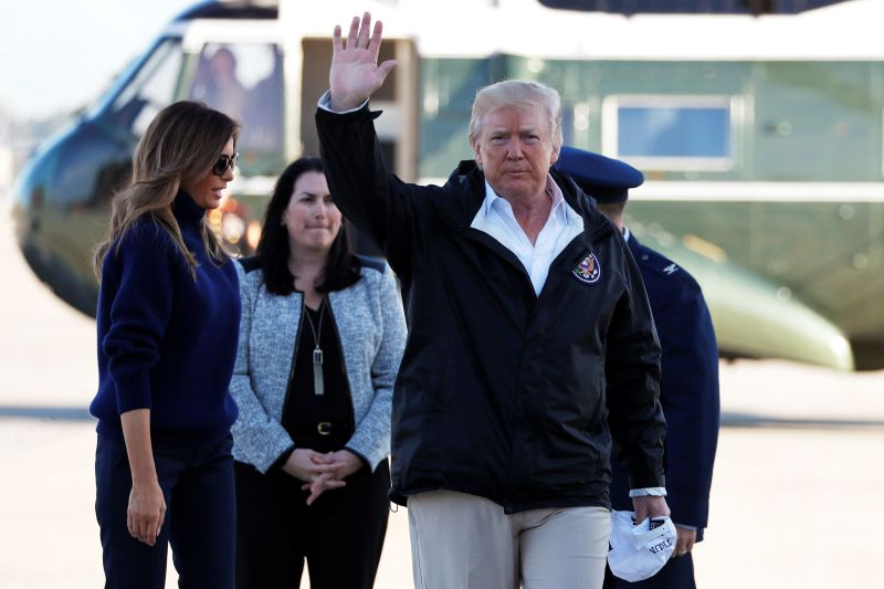 President Donald Trump waves to reporters as he and first lady Melania Trump arrive at Joint Base Andrews, Maryland, to board Air Force One for travel to Puerto Ricoon Oct. 3, 2017.