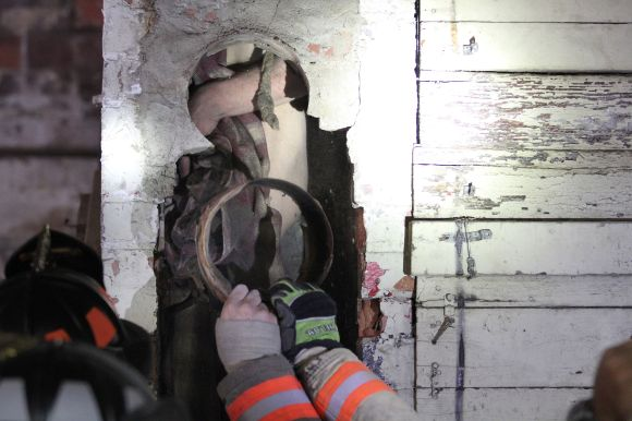 Naked man is rescued from Iowa chimney claims he was just