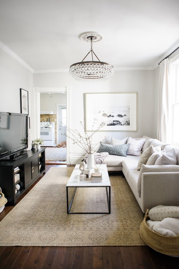 modern small family room ideas with neutral color palette and corner sofa