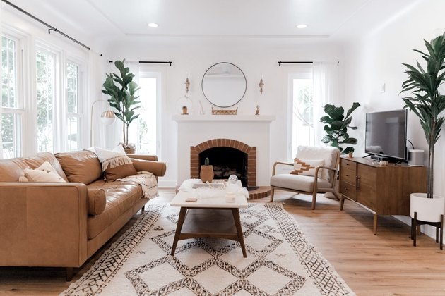Midcentury modern bohemian living room with leather sofa and potted plants
