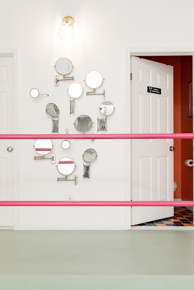 Bright pink painted stair rails in hallway