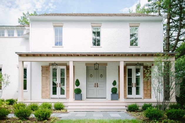 sage green front door color on white house