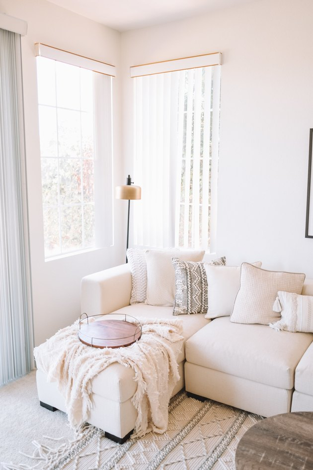 ivory color idea in family room with ivory sofa and throw pillows