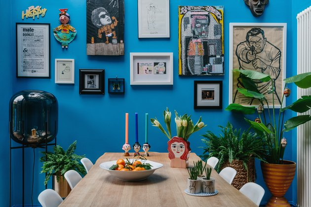 Blue dining room with art and plants