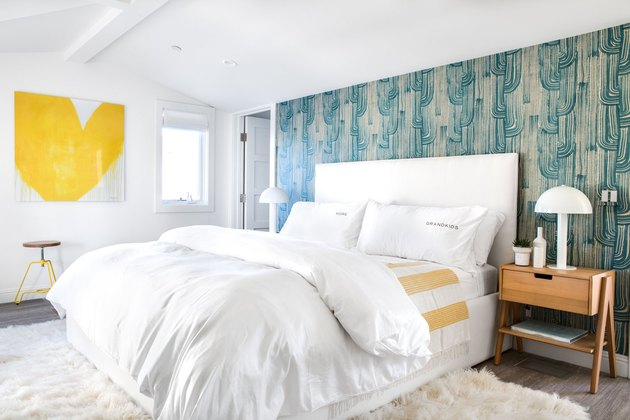 modern colorful bedroom with patterned wallpaper