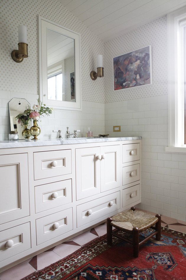 small bathroom wallpaper with blush vanity cabinet and subway tile