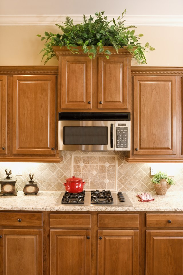What Color Granite Countertops Go With Light Maple ... on Countertops With Maple Cabinets  id=97959