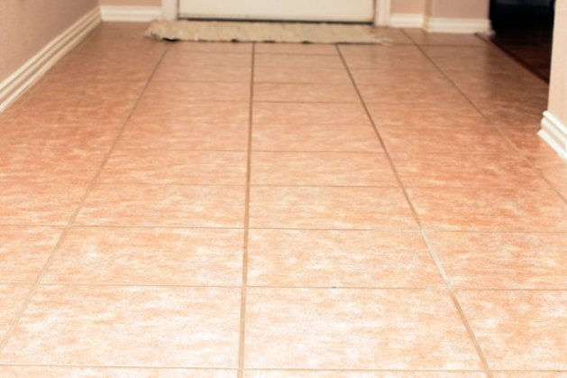 How to Clean Ceramic Tile Floors With Vinegar   Hunker Sweep the floor with a broom  and remove all the debris with a dust pan   Vacuum along the baseboards  and then run the vacuum cleaner over the floor  to