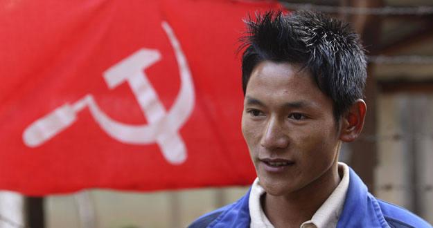 Rodan Rai talks to the media outside his camp in Dudhauli