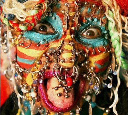 Most Pierced Woman in the world (28 pics)