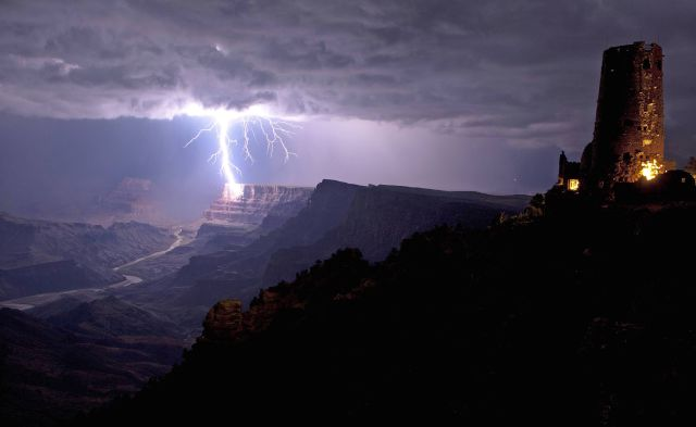 A lightning bolt crashes against the Grand Canyon's South Rim