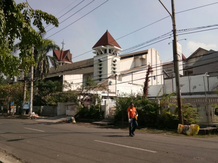 One victim was identified as a member of congregation of the Santa Maria Tak Bercela church on Jl. Ngagel Madya, while the other had yet to be identified.