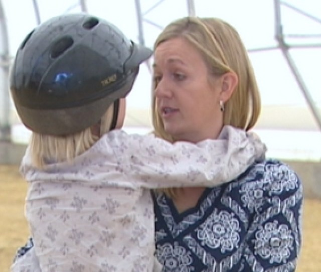 Jodi Bean Talks To Her Daughter Victoria During A Horseback Riding Therapy Session