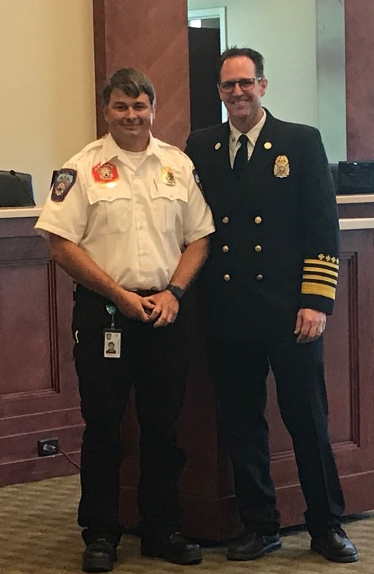 Battalion Chief Matt Burchett (left) poses with Fire Chief Clint Smith (right) at the Draper City Fire Department. Burchett died Monday after sustaining injuries while battling a California blaze. Photo: Draper City Fire Department