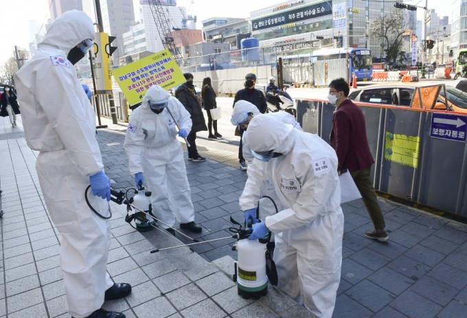 South Korea confirms 827 more coronavirus cases, total nears 6,600