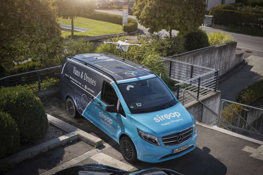 The van whose roof serves as a landing pad for the delivery drone