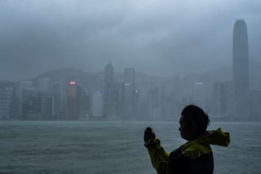A man takes a photo in Hong Kong, China, on the approach of the super Typhoon Mnagkhut, on September 16th.