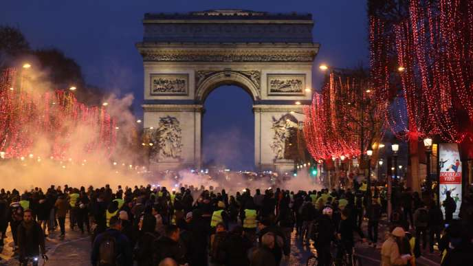 """Demonstration of """"yellow vests"""" on the Champs-Elysees, Paris, January 12."""