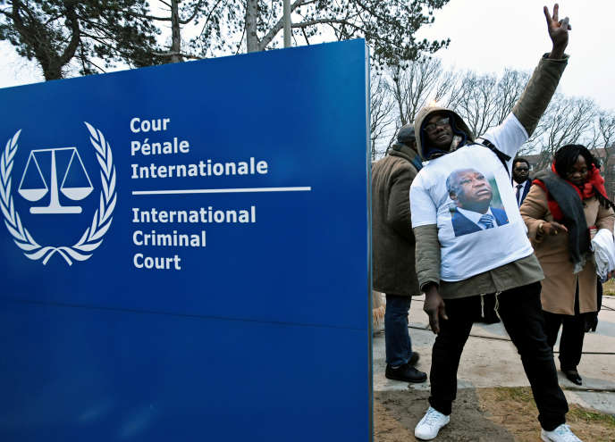A supporter of Laurent Gbagbo celebrates the conditional release of the former Ivorian president on 1 February 2019 at the International Criminal Court in The Hague (Netherlands).