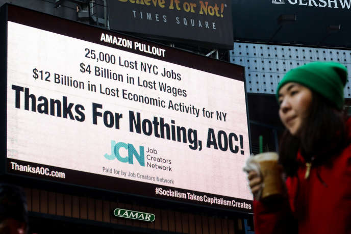 """In New York, February 21, a sign denouncing the role of Alexandria Ocasio-Cortez, """"AOC"""", in the abandonment of the proposed headquarters of Amazon in Queens."""