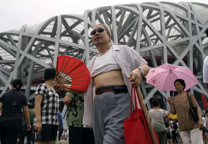 A man with the raised t-shirt comes out of the Beijing National Stadium, China, in August 2009.