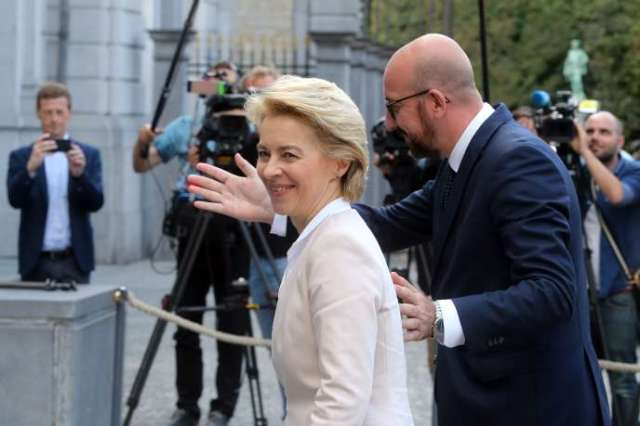 The President-designate of the European Council, Charles Michel, accompanies Ursula von der Leyen, the President-elect of the Commission, to a meeting at the Egmont Palace in Brussels on 8 July 2019.