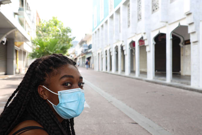 A woman wearing a protective mask on a street in Saint-Denis, capital of Reunion Island, on March 19.