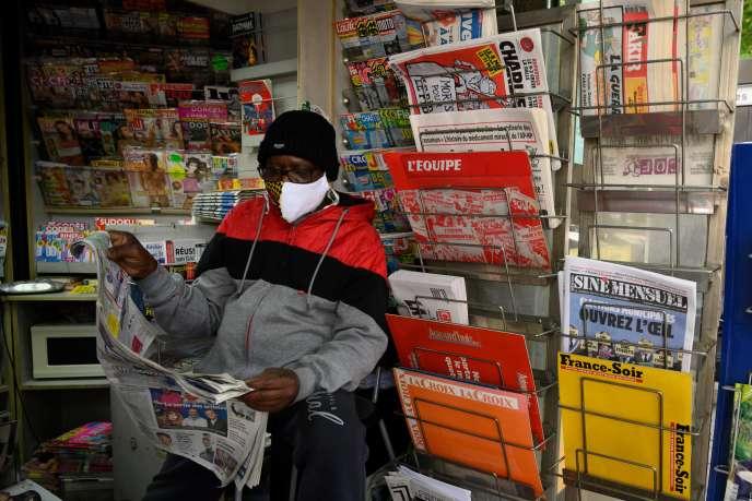 A newsstand reads