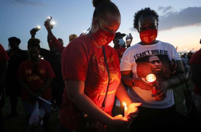 A vigil in honor of George Floyd is held at his old school in Houston on June 8.