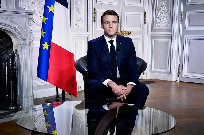 President Emmanuel Macron sends his wishes to the French population at the Elysée Palace in Paris on December 31, 2020.