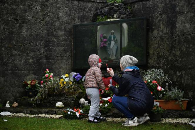 "A mother and her daughter pay tribute in the cemetery of Tuam, Ireland, to the babies who were discovered in the ""house for mothers and babies""."