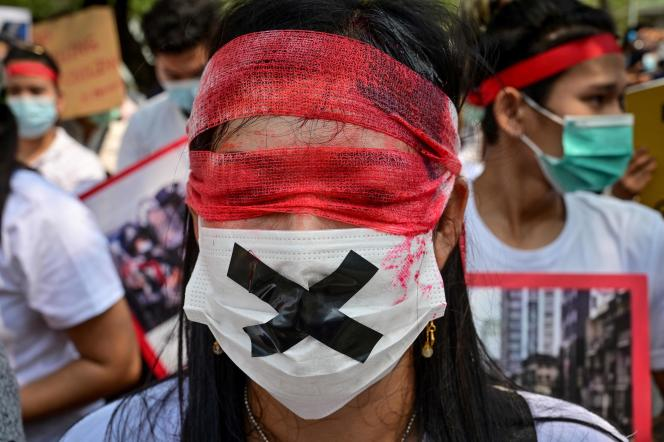 A Burmese protester living in Thailand protests against the coup on February 22.