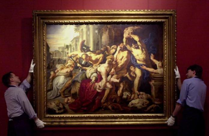 Le personnel de Sotheby's expose «Le Massacre des Innocents» de Sir Peter Paul Rubens (1577-1640), à Londres, le 5 juillet 2002.