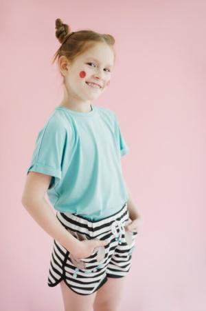 Трикотажный бирюзовый топ с цельнокроеным рукавом на девочку