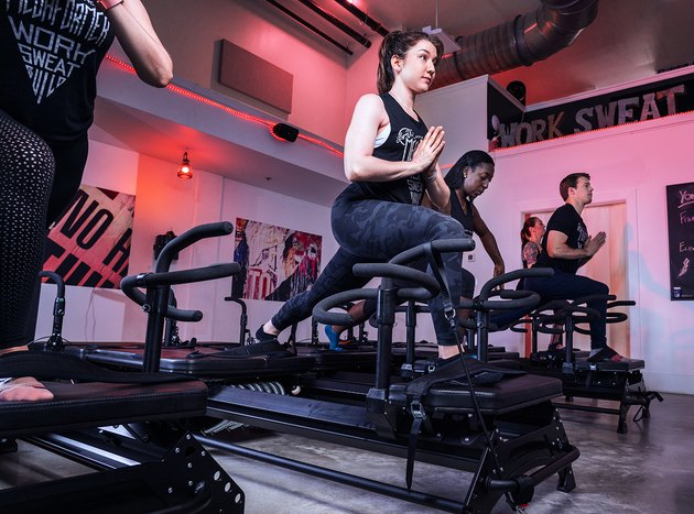 Woman using the Megaformer during a Lagree Fitness Class