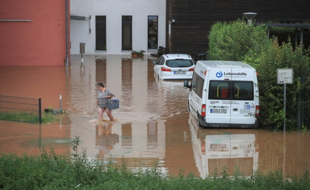 A woman flooded in Germany (Photo: reuters)